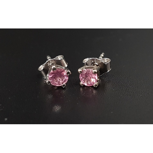 136 - CERTIFIED PAIR OF PINK SPINEL STUD EARRINGS the round cut Mozambican pink spinels totaling 0.57cts, ...