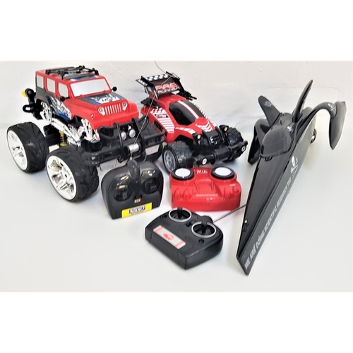 388 - THREE RADIO CONTROLLED VEHICLES including a Nikko Fire Runner off road racer with hand held control ...