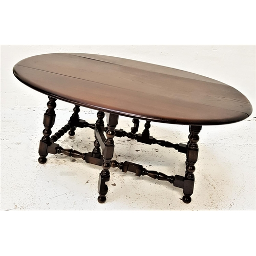 467 - STAINED OAK GATE LEG OCCASIONAL TABLE with shaped drop flaps, standing on bobbin turned supports, 10...