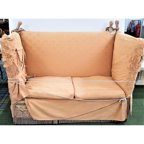 549 - KNOLL TWO SEAT SOFA covered in a floral green and brown material with a fitted yellow loose cover ov...