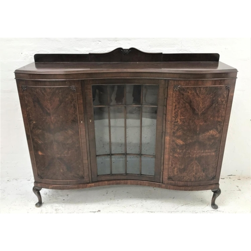 554 - MAHOGANY SERPENTINE FRONTED DISPLAY CABINET with a shaped raised back above a moulded top with a cen...