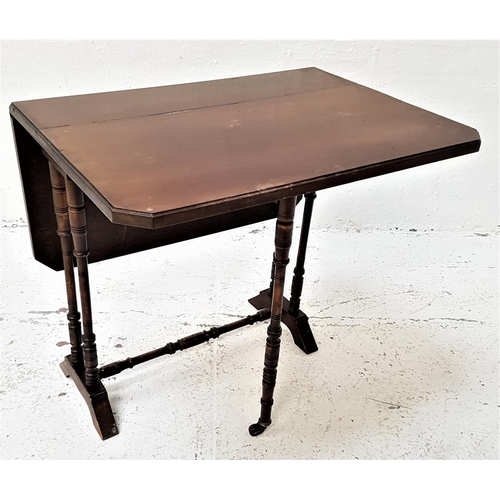 560 - EDWARDIAN MAHOGANY SUTHERLAND TABLE with shaped drop flaps, standing on ring turned supports with po...