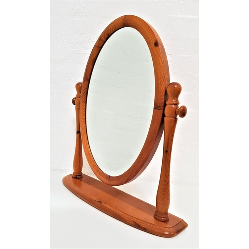 592 - LOVELACE PINE DRESSING TABLE MIRROR with an oval bevelled plate, on a shaped stand, 64cm high...
