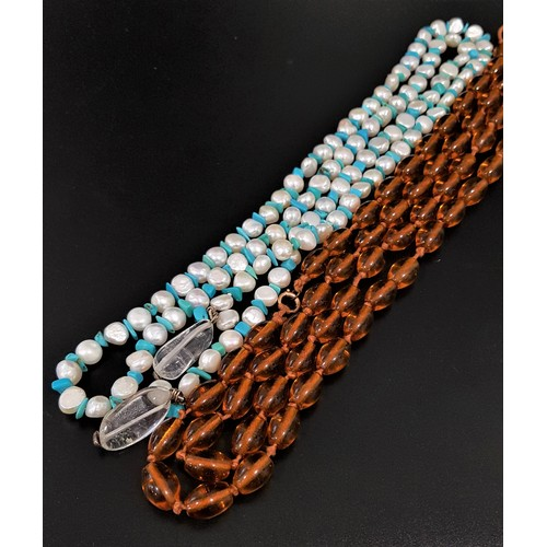 21 - LONG PEARL AND TURQUOISE NECKLACE with a clear crystal to each end, for tie fastening, approximately...