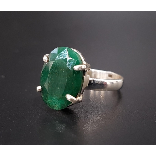 44 - EMERALD SINGLE STONE DRESS RING the oval cut emerald approximately 10cts, on silver shank, ring size...