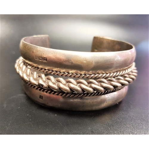 15 - HEAVY EGYPTIAN SILVER BANGLE with central chain effect band, date letter 1930, approximately 108 gra...