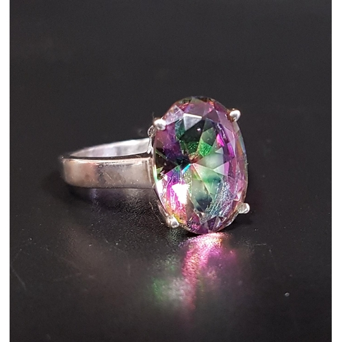 7 - MYSTIC TOPAZ SINGLE STONE RING the oval cut topaz approximately 5.5cts, on silver shank, ring size P