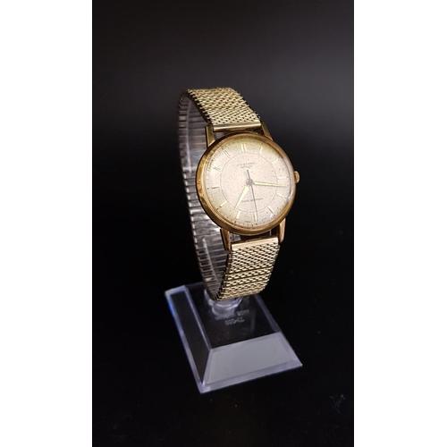 11 - GENTLEMAN'S EIGHTEEN CARAT GOLD CASED J.W. BENSON LONDON WRISTWATCH the dial with baton five minute ...