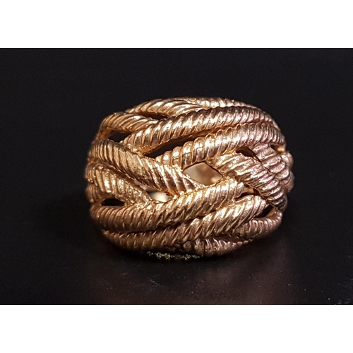 1 - NINE CARAT GOLD BOMBE STYLE RING with entwined rope twist strands, ring size O-P and approximately 6...
