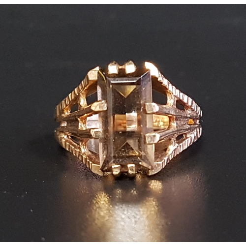 26 - SMOKY QUARTZ SINGLE STONE RING the step cut quartz on nine carat gold shank, with textured and split...