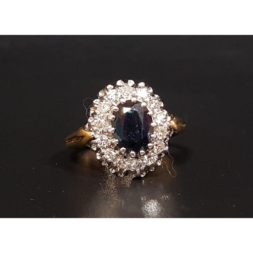 36 - SAPPHIRE AND DIAMOND CLUSTER RING the central oval cut sapphire weighing approximately 1.13cts, in f...