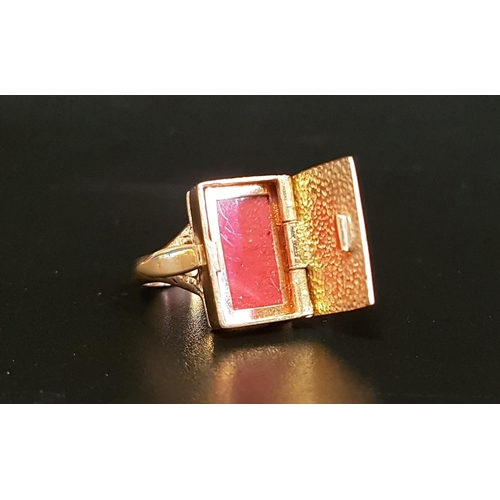 43 - UNUSUAL NINE CARAT GOLD LOCKET RING the rectangular locket section with hinged scroll engraved cover...