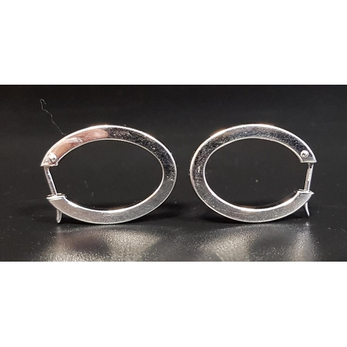 46 - NINE CARAT WHITE GOLD HOOP EARRINGS of oval form, approximately 2.5cm high and total weight 2.8 gram...