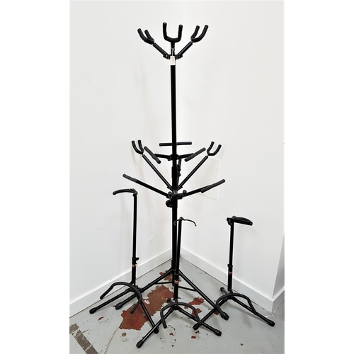 384 - SELECTION OF GUITAR STANDS including three metal single stands and a height adjustable two tier stan...
