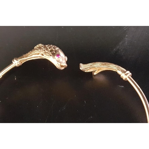 23 - NINE CARAT GOLD FISH DECORATED BANGLE the finials with detailed fish body and tail respectively, wit...
