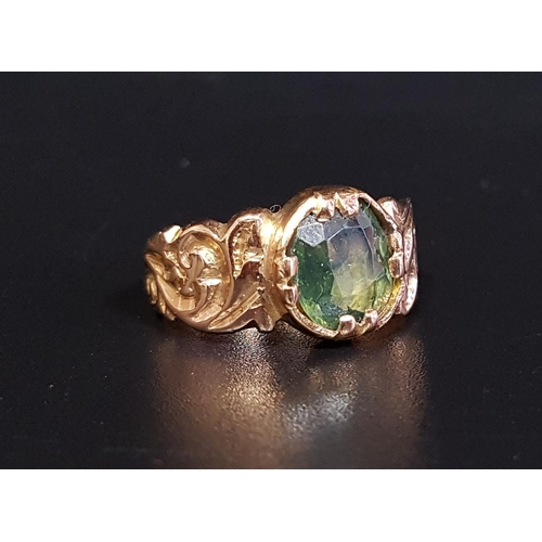39 - 19th CENTURY GREEN GEM SET SINGLE STONE RING possibly tourmaline, on unmarked high carat gold shank ...