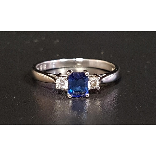 102 - FINE SAPPHIRE AND DIAMOND RING the emerald cut sapphire approximately 0.4cts flanked by diamonds tot...