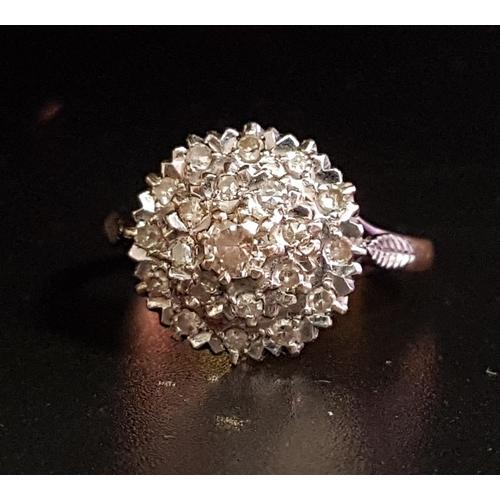 120 - DIAMOND CLUSTER RING the multi diamonds tn circular stepped setting, on eighteen carat gold shank, r...