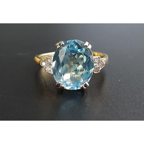 17 - BLUE TOPAZ AND DIAMOND RING the central oval cut blue topaz approximately 4cts, flanked by three sma...