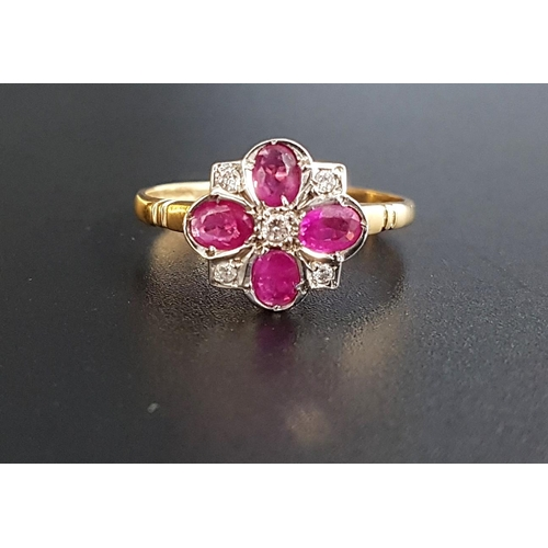 32 - RUBY AND DIAMOND CLUSTER RING the four oval cut rubies separated by small diamonds, on nine carat go...
