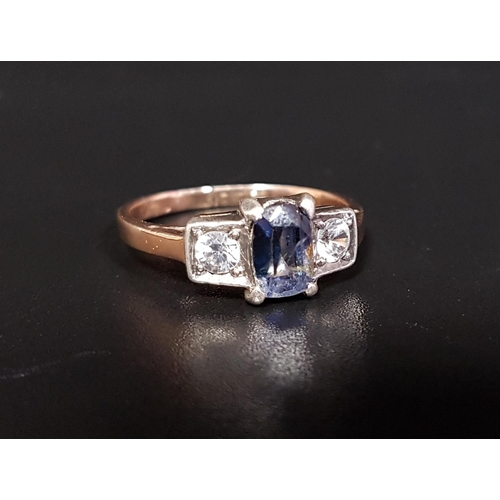 35 - BLUE AND WHITE SAPPHIRE THREE STONE RING  the central blue sapphire flanked by a round cut white sap...