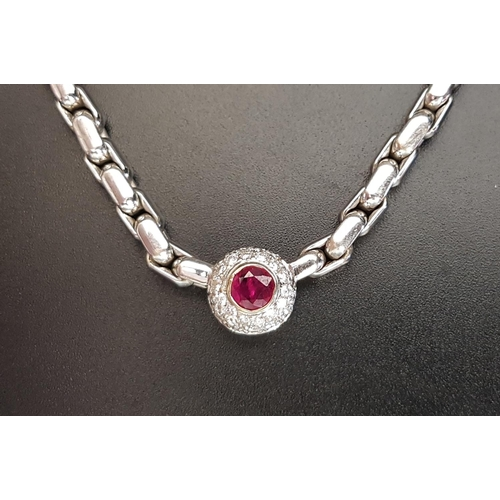 52 - RUBY AND DIAMOND AND NECKLACE the pendant section with central ruby of approximately 0.56cts in pave...