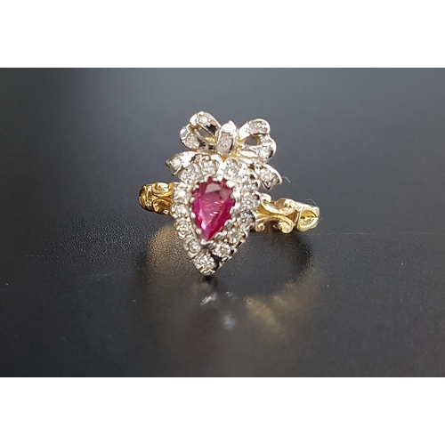 64 - UNUSUAL RUBY AND DIAMOND CLUSTER RING the pear cut ruby in diamond surround and surmounted by a diam...