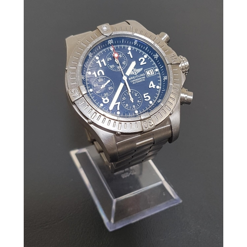 70 - BREITLING CHRONOMETRE AVENGER WRISTWATCH with a titanium case, bezel and bracelet, the circular blue...