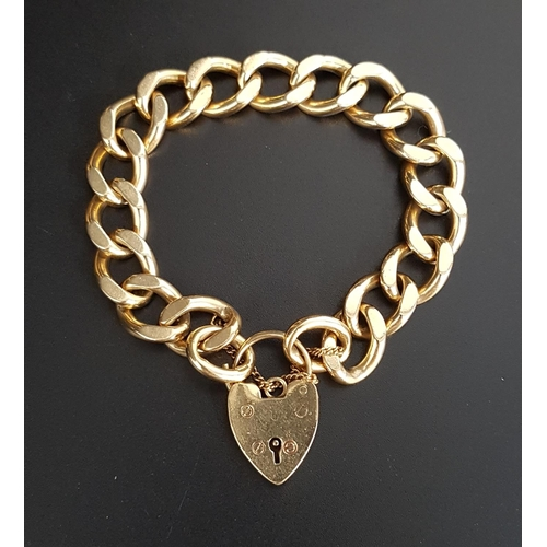 72 - HEAVY NINE CARAT GOLD CURB LINK BRACELET with nine carat gold heart padlock clasp and safety chain, ...