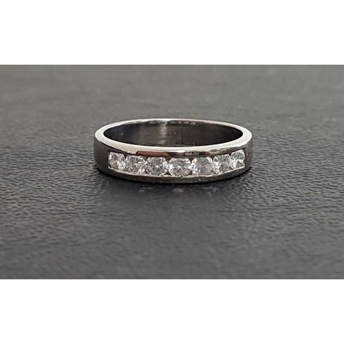 88 - DIAMOND SEVEN STONE RING the channel set round brilliant cut diamonds totaling approximately 0.35cts...