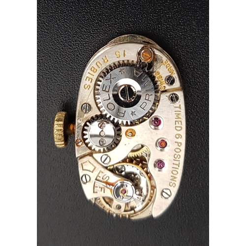 91 - LADIES EIGHTEEN CARAT GOLD CASED ROLEX WRISTWATCH the oval dial with Arabic numerals, on nine carat ...