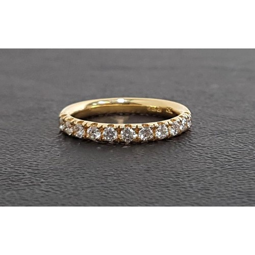 106 - DIAMOND HALF ETERNITY RING the eleven round brilliant cut diamonds totaling approximately 0.44cts, o...