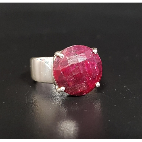 113 - RUBY SET SINGLE STONE RING  the checkerboard faceted cabochon ruby on silver shank, ring size Q-R