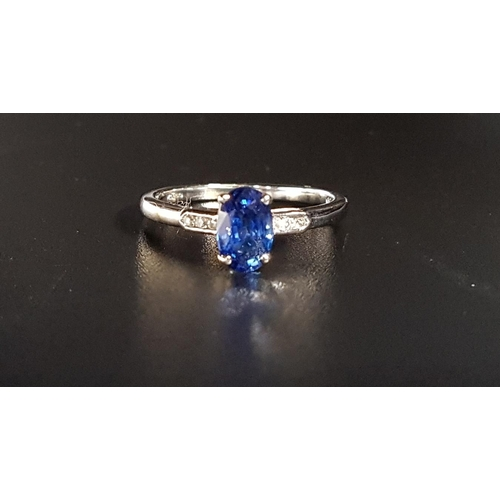 124 - SAPPHIRE AND DIAMOND RING the central oval cut sapphire weighing approximately 0.95cts flanked by th...