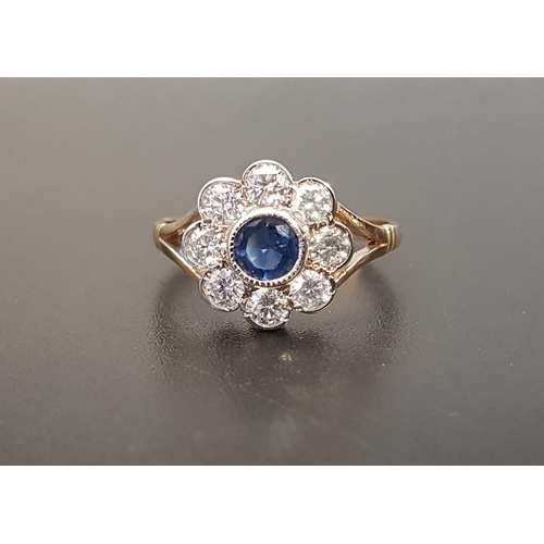 137 - SAPPHIRE AND DIAMOND CLUSTER RING  the central bezel set sapphire approximately 0.35cts in eight dia...