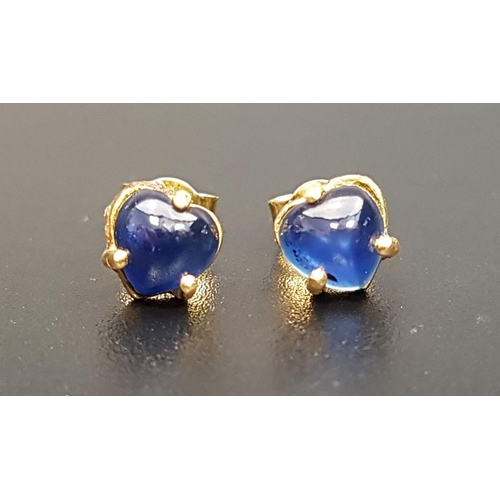 140 - PAIR OF SAPPHIRE STUD EARRINGS the heart shaped cabochon sapphires in unmarked gold, the butterflies...