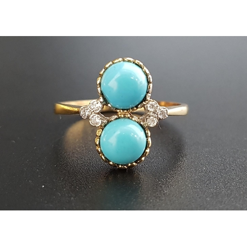 150 - TURQUOISE AND DIAMOND DRESS RING the two round cabochon turquoise stones set in vertical orientation...