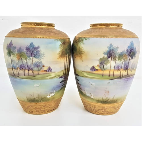 170 - PAIR OF NORITAKE VASES the baluster vases with matching hand painted lake and landscape scenes, with...