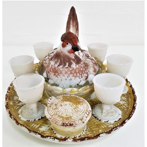 203 - VALLERYSTHAL OPAQUE MILK GLASS HEN ON A NEST BREAKFAST SET comprising a central hen on a nest surrou...