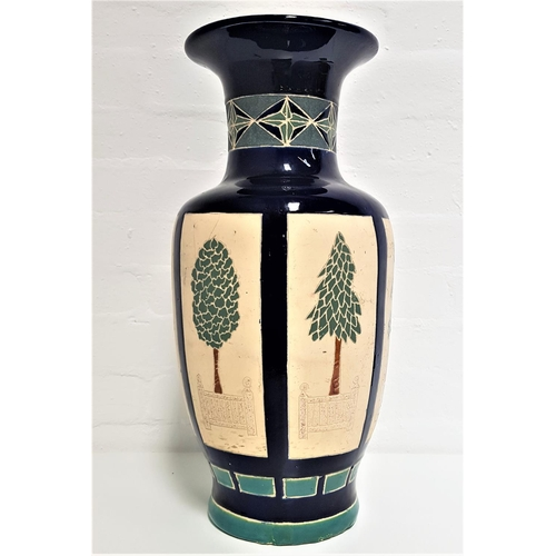 208 - CONTINENTAL POTTERY VASE of baluster form with a blue ground, the neck decorated with a green geomet...