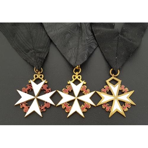 347 - THREE MASONIC DECORATIONS Knights Of Malta white enamel Maltese cross with red enamel lions, on blac...