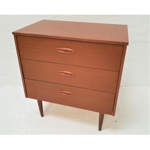 412 - TEAK EFFECT CHEST with three drawers with part inset handles, standing on turned tapering supports, ...