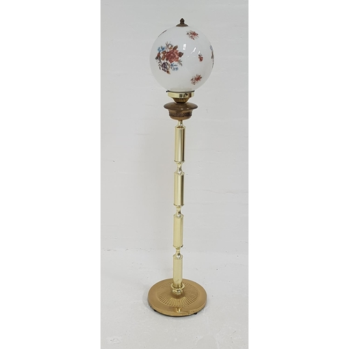 421 - BRASS STANDARD LAMP in the form of an Edwardian oil lamp, raised on a circular base with a four sect...