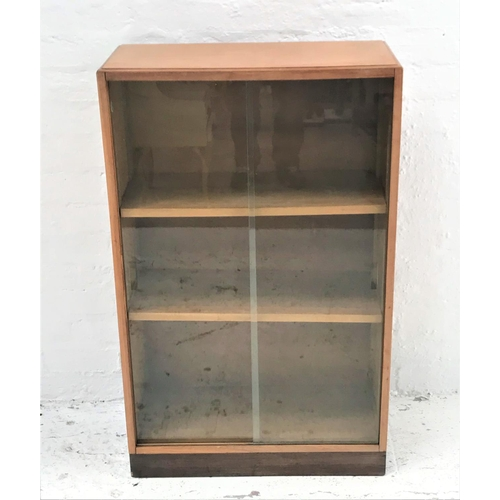 427 - OAK BOOKCASE with a rectangular moulded top above a pair of sliding glass doors with two adjustable ...