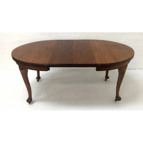 432 - EDWARDIAN OAK EXTENDING DINING TABLE with D ends, two extra leaves and a wind out mechanism, standin...