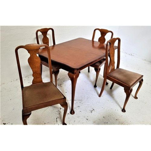 437 - BURR WALNUT AND CROSSBANDED DINING TABLE AND FOUR CHAIRS the table with a shaped pull apart top and ...