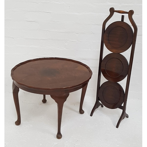 440 - WALNUT OCCASIONAL TABLE with a wavy rim and standing on cabriole supports, 42cm high, together with ...