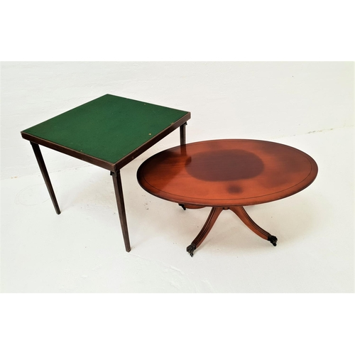 456 - OVAL MAHOGANY OCCASIONAL TABLE raised on a central column with four outswept supports with lion paw ...