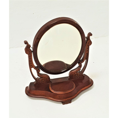 457 - VICTORIAN MAHOGANY DRESSING TABLE MIRROR with an oval plate on shaped carved supports, above a shape...
