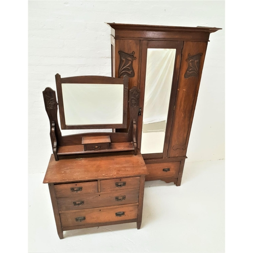 461 - ARTS AND CRAFTS OAK WARDROBE with a moulded cornice above a central mirrored door flanked by stylise...